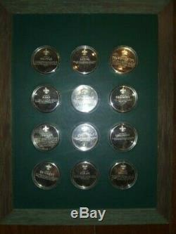 Norman Rockwell's Spirit of Scouting Sterling Silver 12 Coin Medallion Set